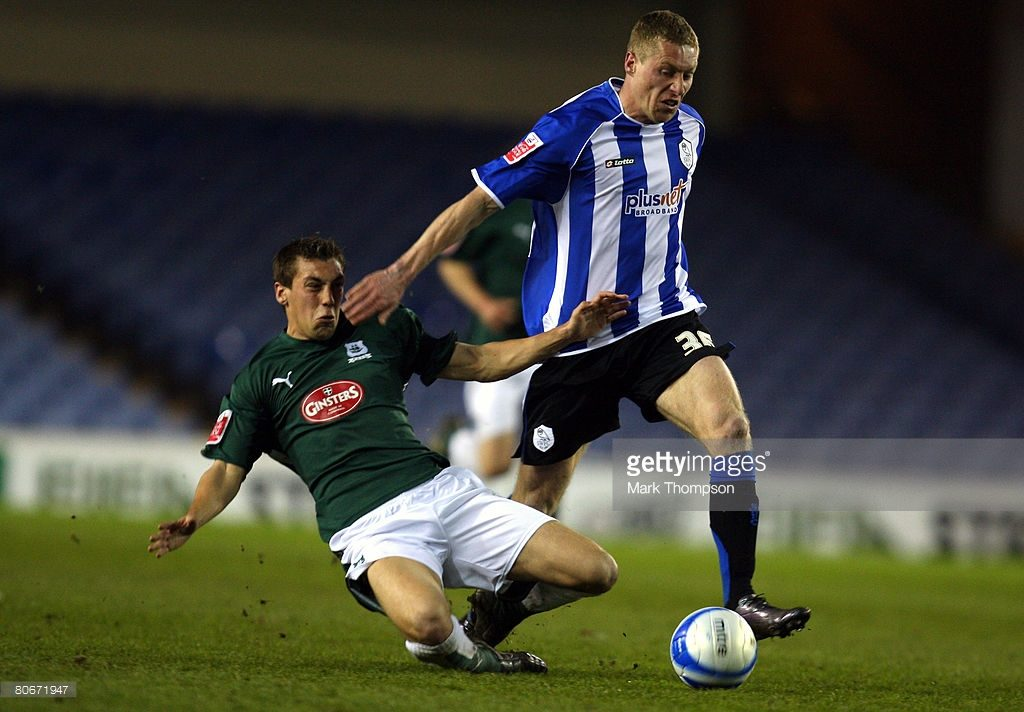SHEFFIELD, UNITED KINGDOM - APRIL 14: Bartosz Slu/sarski of Sheffield Wednesday tangles with Gary Sawyer of Plymouth Argyle during the Coca-Cola Championship match between Sheffield Wednesday and Coventry City at Hillsborough on April 14, 2008 in Sheffield, England. (Photo by Mark Thompson/Getty Images)